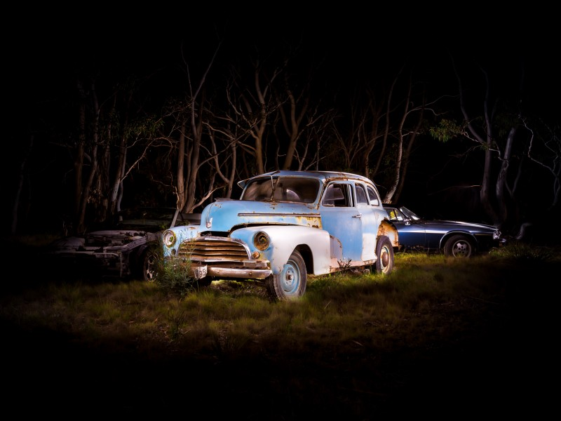 Automotive photography of 1950's Chevrolet and XJS Jag at Night