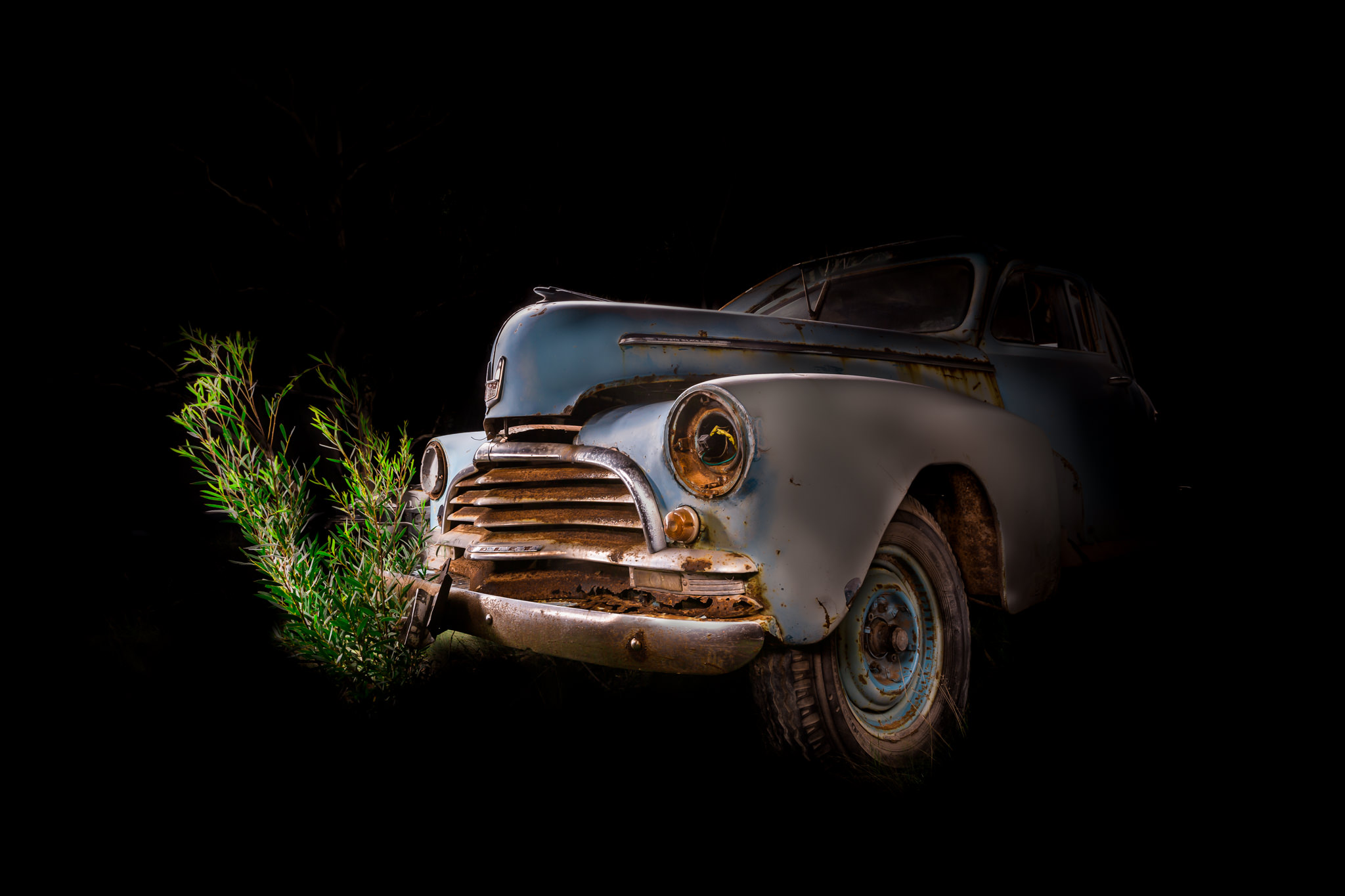 Automotive photography of 1950's Chevrolet front quarter at Night